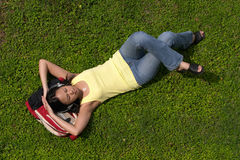 Female Asian Student Resting on Backpack Royalty Free Stock Photography