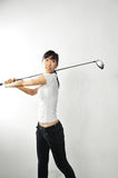 Female Asian swinging Golf Clubs Royalty Free Stock Photos