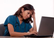 Female asian thirties medical personnel headache Stock Photo