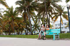 Female Asian Tourists People Watch Along Miami Beach Recreationa Royalty Free Stock Images