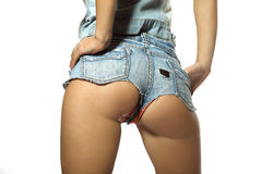 Female ass in blue jeans shorts Royalty Free Stock Photos