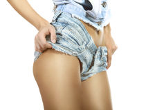 Female ass in blue jeans shorts Stock Images