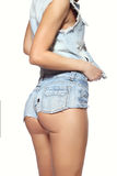 Female ass in blue jeans shorts Royalty Free Stock Photo