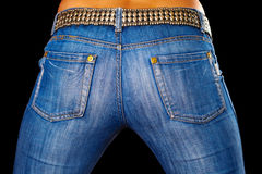 Female ass dressed in jeans on black Royalty Free Stock Photography
