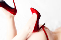 Female ass and legs with red high heels Stock Photos