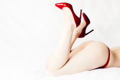 Female ass and legs with red high heels Royalty Free Stock Photos