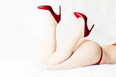 Female ass and legs with red high heels Royalty Free Stock Image