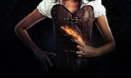 Female Assassin Holding Antique Flaming Pistol Royalty Free Stock Image