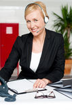 Female assistant communicating with client Stock Photography