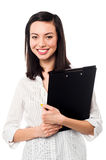 Female assistant holding business files Royalty Free Stock Images