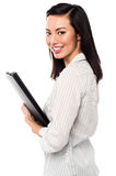Female assistant holding business files Stock Photography