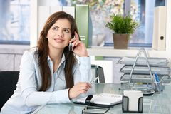 Female assistant on phone Royalty Free Stock Photography