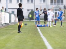 Female assistant refere in action during football. Female assistant refere in action royalty free stock images