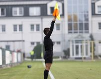 Female assistant refere in action during football. Female assistant refere in action royalty free stock photo