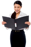 Female assistant reviewing file Stock Photos