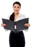 Female assistant reviewing file Royalty Free Stock Photos