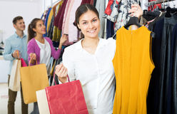 Female assistant serving happy customers Stock Photo