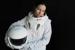 Female astronaut on a black background. Fantastic space suit. Exploration of outer space. Female astronaut on a black background. Fantastic space suit Stock Photos