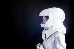 Female astronaut looking left on something. Fantastic space suit. Exploration of outer space. Royalty Free Stock Images