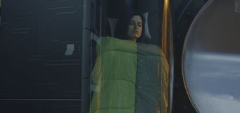 Free Female Astronaut Sleeping In A Glass Pod Stock Images - 160671674