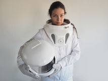 Female astronaut on a white background. Fantastic space suit. Exploration of outer space. Female astronaut on a white background. Fantastic space suit Royalty Free Stock Image