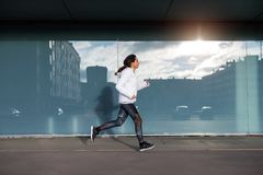 Sporty woman running and exercising in the city Stock Image