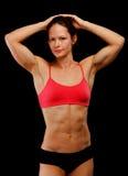 Female athlete. Posing against black background Royalty Free Stock Image