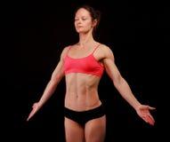 Female athlete. Posing against black background Stock Photo