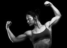 Female athlete. Posing against black background stock photos