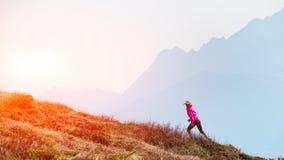 Female athlete ago in the mountains training stock image