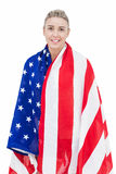 Female athlete with american flag on her shoulders Stock Photo