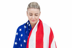 Female athlete with american flag on her shoulders Royalty Free Stock Photos