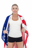Female athlete with american flag on her shoulders. On white background Stock Photo