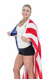 Female athlete with american flag on her shoulders. On white background Stock Photography