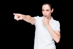 Female athlete blowing a whistle and pointing Stock Photos