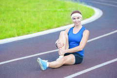 Female Athlete During Body Stretching Exercises Outdoors Royalty Free Stock Photos