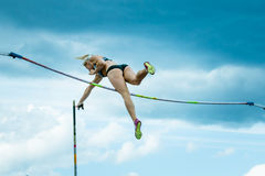 A female athlete competing in the pole vault. Chelyabinsk, Russia - June 10, 2015: A female athlete competing in the pole vault during The universities Royalty Free Stock Photos