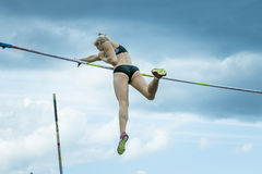 Female athlete competing in the pole vault. Chelyabinsk, Russia - June 10, 2015: A female athlete competing in the pole vault during The universities Stock Images