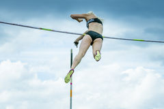 Female athlete competing in the pole vault. Chelyabinsk, Russia - June 10, 2015: A female athlete competing in the pole vault during The universities Stock Photography