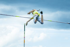 Female athlete competing in the pole vault Royalty Free Stock Photos