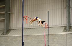 Female athlete competing in the pole vault. Women's high jump, National Collegiate Athletic Association (NCAA) 2016 Indoor Track and Field event at Dix Stadium Stock Image