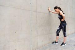 Female athlete complete holiday self training Stock Photos
