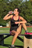 Female athlete cooling down Royalty Free Stock Photography