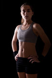 Female Athlete in the Dark Royalty Free Stock Photography