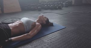 Female athlete doing deep breathing exercise stock video footage