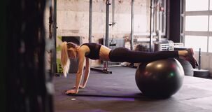 Female Athlete Doing Pilates Workout At Health Club