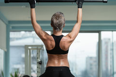 Female Athlete Doing Pull Ups Royalty Free Stock Images