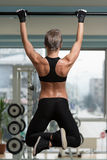 Female Athlete Doing Pull Ups Royalty Free Stock Photos