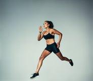 Female athlete doing running exercise royalty free stock image