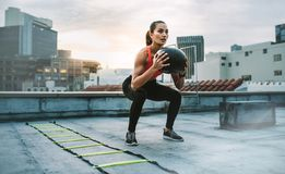 Fitness woman doing exercises on rooftop royalty free stock images